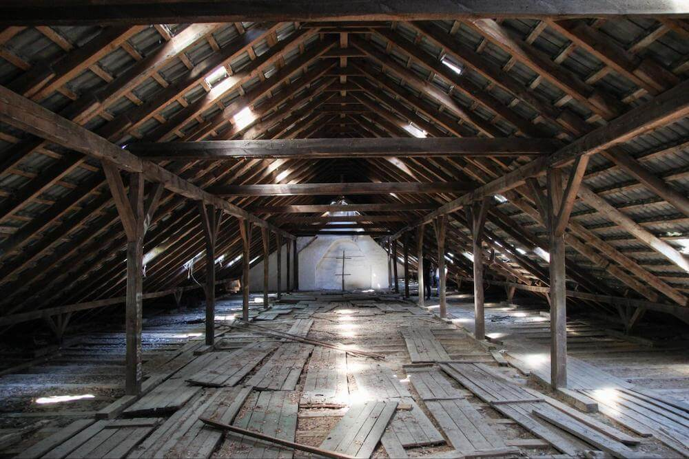 Empty wooden attic with sky lights
