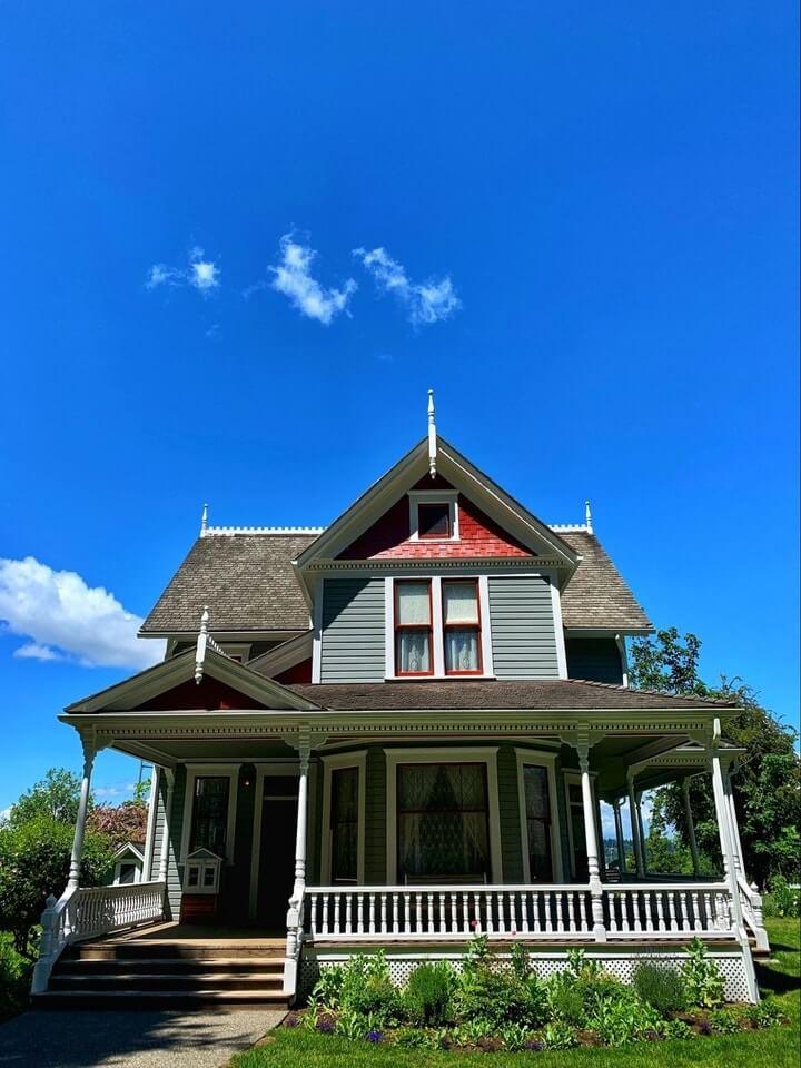 a wooden house under a blue sky